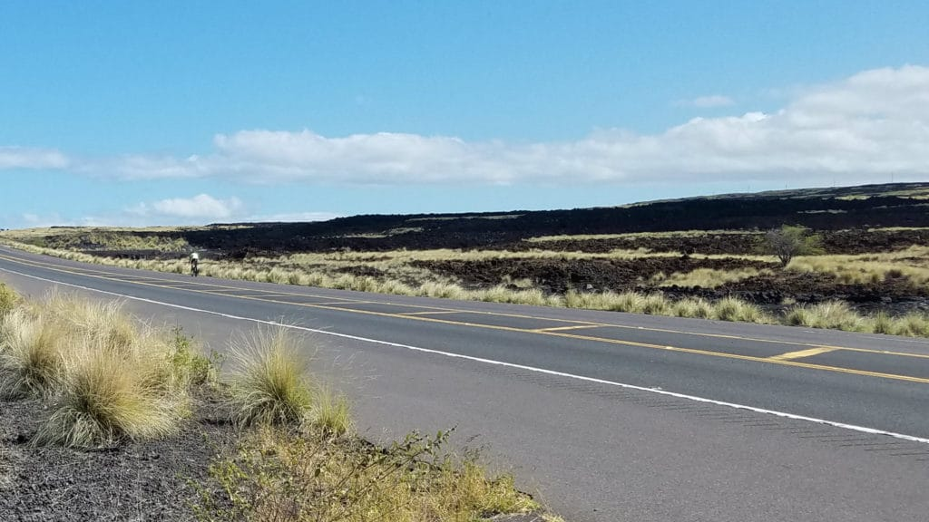 biking along the Queen Ka'ahumanu Highway near Kona, Hawaii