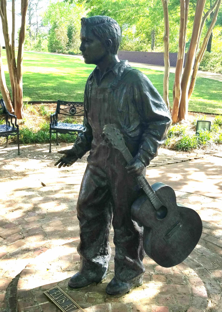 Statue of young Elvis Presley at the Elvis Presley Birthplace Visitor Center. Elvis began singing specials at the First Assembly of God church at age 9.