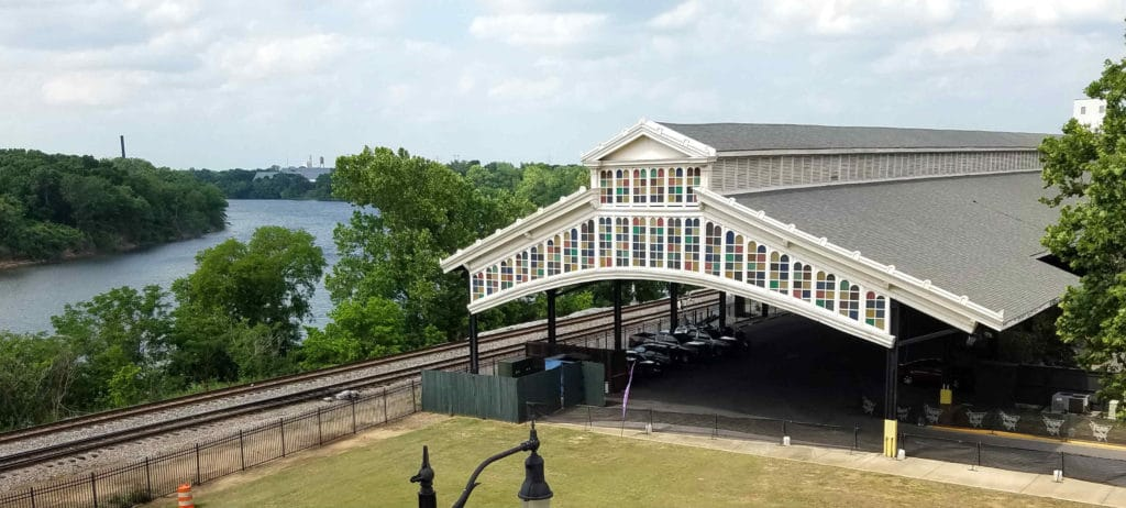 The historic Union Station Train Shed (location of the triathlon transition area) with Alabama River (location for the swim) in the background.