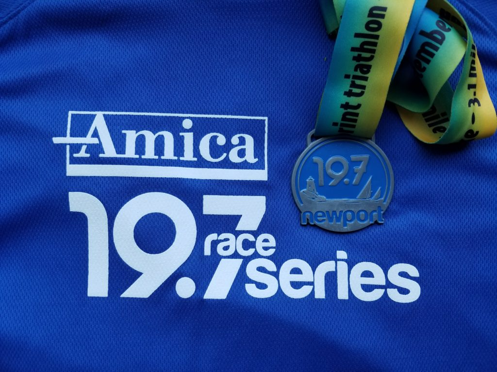 T-shirt and finisher medal from the 2012 Amica Newport 19.7 triathlon