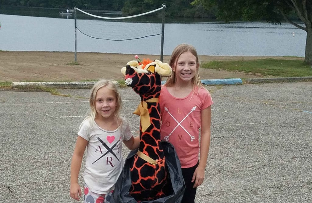 two-young-girls-with-stuffed-giraffe-at-the-Ohio-triathlon