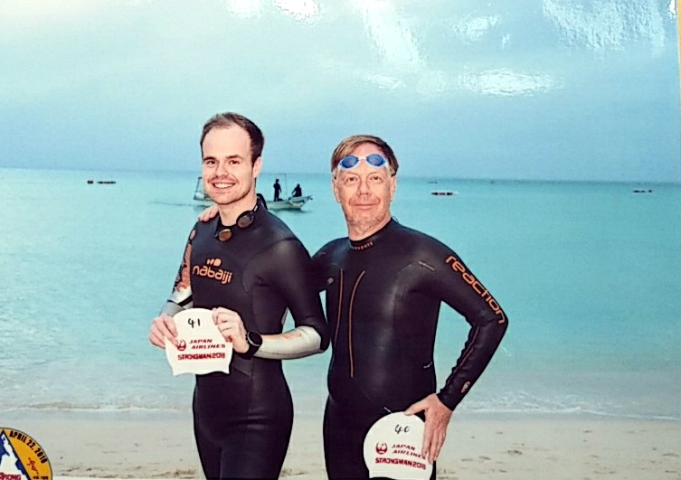 Laurent Labbe and his oldest son on the beach in front of the swim course at the Strongman All Japan Triathlon.