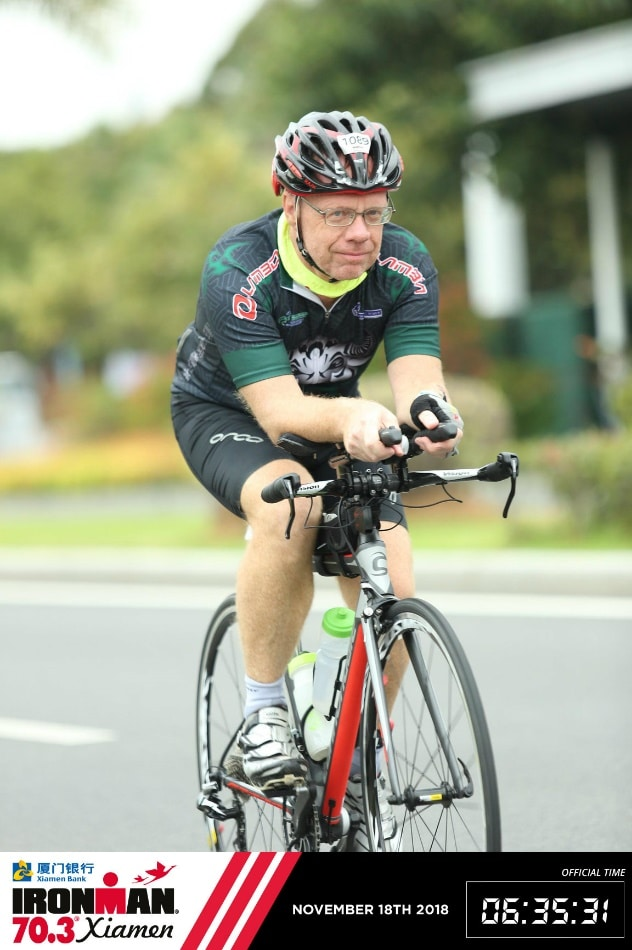 Laurent Labbe on the bike at Ironman 70.3 Xiamen, China