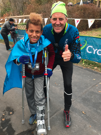 Tony Schiller with four-time finisher of the CycleHealth Resilinator.  This time, the young man finished the 2.4 mile course using crutches,