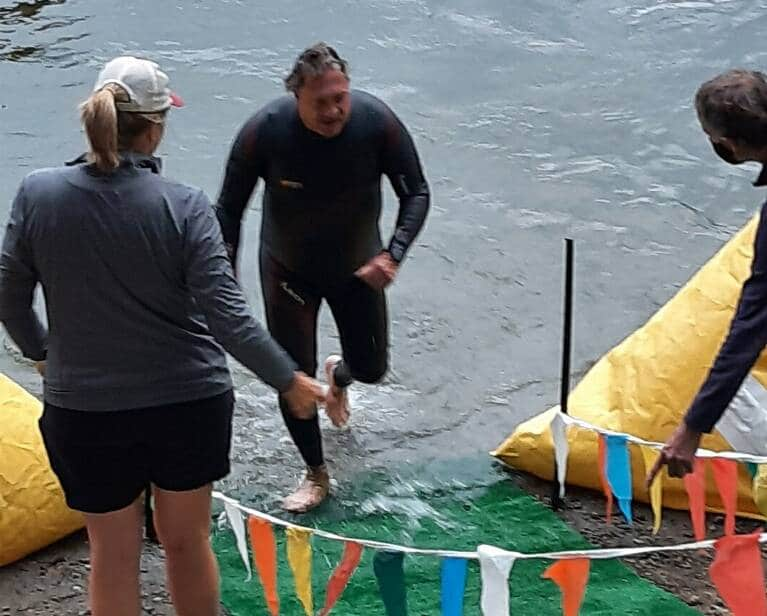 Craig Cross exiting the swim at Whidbey Island Triathlon in July 2021.